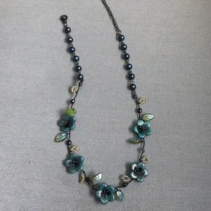 Necklace in teal and green colors.